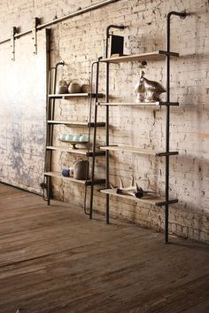 Leaning wood and metal wall shelving unit could easily be used on a kitchen…