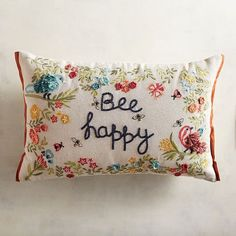 Heard the buzz about our Bee Happy pillow? It's swarming with flowers, birds, butterflies and, of course, bee-utiful winged creatures, all embroidered on a cotton cover.