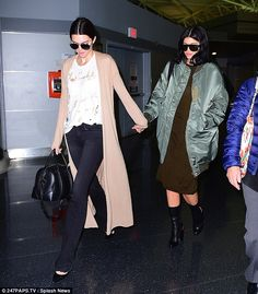 Leader: Kendall led the way as she held her sister's hand through the airport