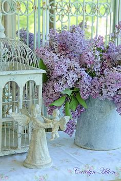 This looks like a scene from www.hendersonmemories.com  Angels, birdcages, pretty antique vases and pitchers