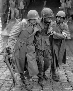 A wounded Officer of the 501st PIR 101st Abn Div is being...