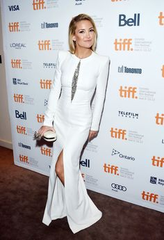 Kate Hudson in a long sleeve, thigh high slit white dress. Celebrities at the Toronto Film Festival 2012