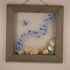 Catching a wave. Sea shell, blue beach glass, handmade bird by SeasidesbyDesign on Etsy
