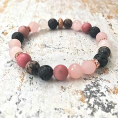 Excited to share the latest addition to my #etsy shop: Pink Essential Oil Diffuser Bracelet, Black Lava Bead Aromatherapy Bracelet, Pink Gemstone Beaded Bracelet, Rose Quartz Diffuser Bracelet