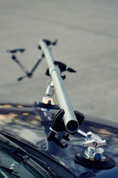 DiY camera rig for car photography - could easily be adapted for video use too.
