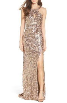 Free shipping and returns on Mac Duggal Sequin Cowl Back Gown at Nordstrom.com. Iridescent sequins create a play of shimmering color down the slinky length of a halter-style gown that makes a memorable entrance and a head-turning exit. A slender keyhole punctuates the bodice, a slit runs up to there at the skirt and the open back is elegantly draped to echo the trailing hem.