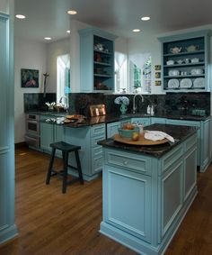 Custom cabinets painted in Benjamin Moore's Wythe Blue. When can I move in?! I think the only thing I would change in here is the window treatments.