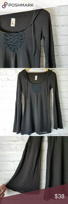 """Free People • Intimately Bell Sleeve Hoodie Beautiful charcoal hoodie with black crochet accent at bust and along hem. Features flared bell sleeves. Stretchy, lightweight material.  • Approx 17"""" armpit to armpit  • Approx 28"""" length  Excellent gently preloved condition with no rips, holes or stains.  No holds, trades or off-posh transactions. Free People Tops"""