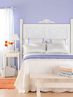 Pair with White: Youthful purple coats the walls in this sweet bedroom.  Make it work for you:  -- Use all-white furniture to counterpoint the bright shade.  -- Don't be too matchy: Attach baby blue paper to the headboard or use another cool shade somewhere else.  -- Accent with a warm color (like the tangerine rug and bedding here)