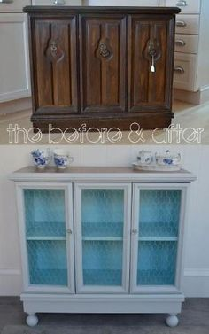 This would be perfect for a coffee bar in a kitchen or dining room. White exterior and navy interior? Heaven. by addie