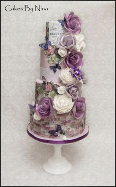 Really love the colour combination of this cake, I wanted to create a ribbon effect around the bottom in rice paper, this is a combination of sugar peonies and rice paper flower, added some gorgeous bling, hope you like it too and thanks for looking Violet Wedding Cakes, Violet Cakes, Wafer Paper Flowers, Wafer Paper Cake, Paper Roses, Cake Design Inspiration, Wedding Cake Inspiration, Daily Inspiration, Gravity Cake