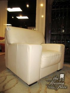 """Handsome Maxdivani leather chair in a cream color. This chair has such clean, crisp lines that make it ideal for a contemporary style home. 39""""wide x 36""""deep x 36""""high. At posting, we have two and the matching sofa."""