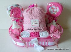 A unique baby gift basket with an assortment of goodies for mom and baby! Description from catchmyparty.com. I searched for this on bing.com/images