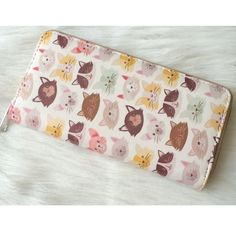 "Animal wallet Cat wallet. Measures 7.5"" long and 4"" tall. Brand new in original packaging. The exterior has a faux leather look and feel. Zipper closure with silver hardware. The inside has two billfolds, eight card clots, and one zippered pouch.  Price is firm unless bundled. No trades ⭐️This is a retail item. It is brand new either with manufacturers tags, boutique tags, or in original packaging.  Availability: 7 Bags Wallets"