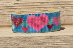 """Beautiful Hearts  On-loom woven cuff bracelet by Bluesbeadweaving Included in """"A Gift Of LOVE Treasury"""" by the Beading on a Loom team, by Sandy Cervera on Etsy ."""