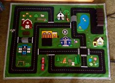 Car felt play mat.  Designed for my grandchildren.  2015