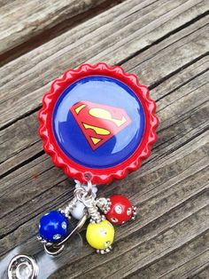 I think I'm going to make one of these for my peds rotation. Maybe the kids will like me more ;-). Superman  Inspired ID Badge Reel Bottle Cap