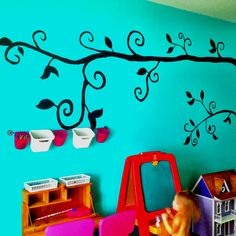 Tree mural I painted on wall of playroom
