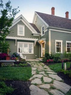 Exterior house color schemes can show off detail, minimize poor appearances and increase curb appeal. Selecting the right house paint makes all the difference. Green Exterior Paints, Green Siding, Exterior Paint Colors For House, Paint Colors For Home, Cottage Exterior Colors, Exterior Paint Ideas, Best Exterior Paint, Exterior Design Of House, Gray Exterior Houses