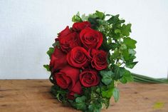 ramo-novia-rosas-rojas. You may have paper or fabric flowers for decorations but if you want I will make you a real bouquet