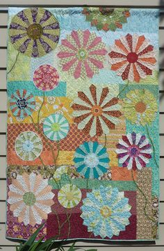 A Dresden plates quilt by Kim McLean - from a pattern designed by Kathy Doughty.  Talent everywhere!