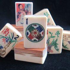 1920s bone and bamboo 1 dot mahjong tile and other tiles.  Multicolor, fancy 1 dot tile.