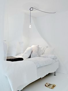 Hanging bulbs in white bedroom