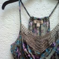 Decree Green Floral Crochet Racerback Tank Decree brand from JC Penney, size medium, in great condition! This racetrack tank is adorable with the crochet neckline, blue pink and purple floral print on green, and elastic babydoll waist. This is super flowy and perfect for summer! Some pilling from wear and wash. Please ask any and all questions before purchasing. No trades. Make a reasonable offer. Thanks! Decree Tops Tank Tops