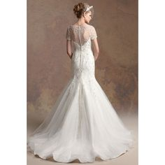 Wedding Dresses found on Polyvore - not the bottom as much as the top of the dress do I find delicate and pretty.....