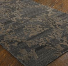 Tavenna Wool Rug (Dark Grey and Rust/Beige) - 8' x 10' : $$, 9' x 12' : $$. Available online at www.TheLookInteriorsNH.com