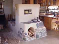 Rocket stove mass heater is one of the cleanest, most sustainable way to heat conventional homes; highly efficient wood-burning with zero carbon footprint.