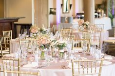 Blush, ivory and gold wedding reception, flower centerpieces and gold chiavari chairs, gold linens and white napkins with petals and favours - Pinch me! Weddings & Events YYC | Norina Kaye Photography