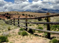 The pole fence seems to peacefully ramble on across the Utah desert. # 282