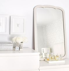 """Plush Palate: March 2010    DIY vanity Inexpensive chests of different heights make a comely dresser when topped with a vintage mirror. """"It's important to put your own stamp on mass-market furniture,"""" Ann Marie Favot says."""