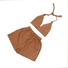 SALE  Last few sets left!  Update your wardrobe this season with our brown bralet shorts co-ord two piece twin set. Our two piece features a high waisted shorts and a bralet top that ties up at the back and neck in a soft woven fabric. Style outfits wearing the top and bottom separately and get more than your money worth with our wardrobe essentials. Our tartan two piece is hand made in our London studio, please see our size guide for details. We keep this fabric in stock so this piece can…