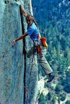 Shot of a very young Lynn Hill crack climbing at Tahquitz Rock Idyllwild, California