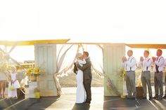 wedding ceremony - photo by Sarah Tamagni Photography http://ruffledblog.com/stormy-day-plane-hangar-wedding