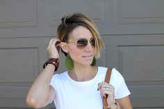 asymmetrical pixie cut, leather earrings, leather wrap cuff