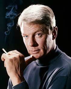 Peter Graves US actor wearing a black turtleneck sweater holding a lit cigarette with the smoke rising to the left of the image in a portrait issued. Iconic Movies, Old Movies, Mission Impossible Tv, Peter Graves, Diva E, Spy Shows, People Smoking, Actor James, Vintage Television