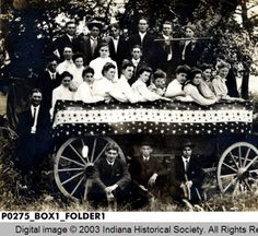 Young Adults Posed on a Wagon :: Otto Ping photograph brown county Indiana. 2nd Great Grandmother Mary Ping, her sister Carrie Ping and Mary's sister-in- law, Aunt Zora