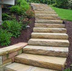 Hand faced sandstone steps.  sophisticated, lots of character, natural stone never goes out of style!  Designed and installed by eichenlaub. #steps