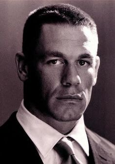John Cena. After graduating from Cushing Academy, Cena attended Springfield College in Springfield, Massachusetts. In college he was a Division III All-American center on the college football team, wearing the number 54, which is still used on some of his WWE merchandise. He graduated from Springfield in 1998 with a degree in exercise physiology.