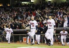 Minnesota Twins players react as Josh Willingham hits a three-run home run against Oakland Athletics pitcher Brian Fuentes during the ninth inning to win the baseball game 3-2, Tuesday, May 29, 2012, in Minneapolis.