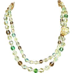 Absolutely superb, double strand of faceted, cut crystal beads from the 1960s in jonquil yellow, delicate green and warm brown. Fancy Clasp, Perfect