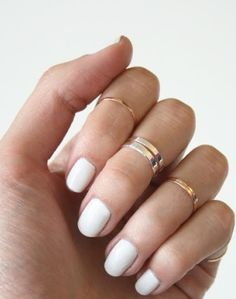 white nails and gold rings