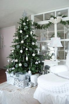 Christmas tree with white and silver decorations