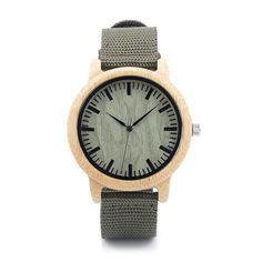 This sleek, sexy gray scale wooden watch is one of the hottest trends on the market today. Solid wood face with accented modern greenish-gray mesh band makes this piece easy to wear and nice to look a