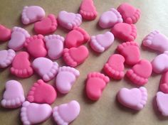 You will receive 30 Edible baby feet - 15 pairs  Baby pink and pink  These measure approx 10mm - Perfect for decorating your homemade or shop bought cupcakes  Made from professional sugarpaste/ fondant and are completely edible  Handmade to order and will require 3 days drying time before being posted. I recommend ordering 1-2 weeks before your event. These toppers are gluten free and suitable for vegetarians  I ship worldwide with a flat rate postage cost. Uk orders are sent standard 1s...