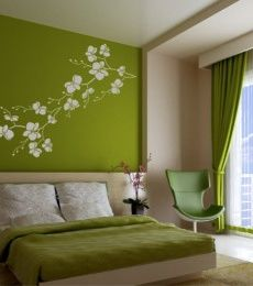 Green Bedroom Wall With White Flowers Branch Stencil And Bedding