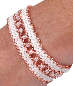 White Beauty Bracelet (lace two strips of peyote stitch together for a dainty band), pattern by Tatiana Zakharova Beaded Braclets, Beaded Bracelet Patterns, Seed Bead Bracelets, Seed Bead Jewelry, Jewelry Patterns, Beaded Jewelry, Handmade Jewelry, Peyote Bracelet, Seed Beads